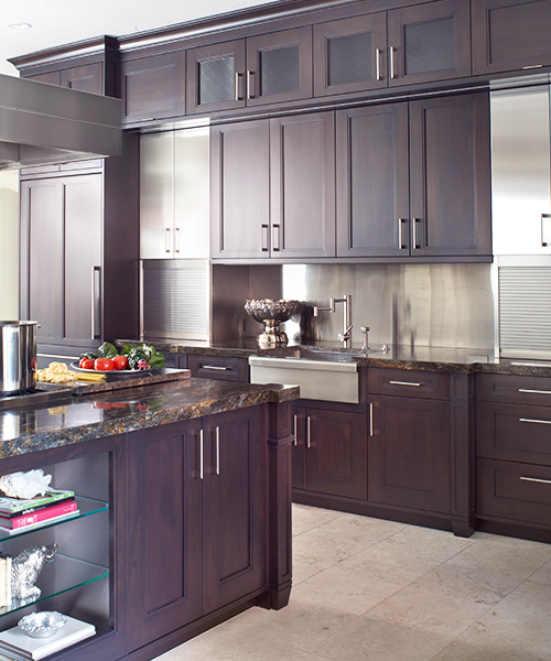 Dark wood custom cabinetry in kitchen created by William Ohs in Denver