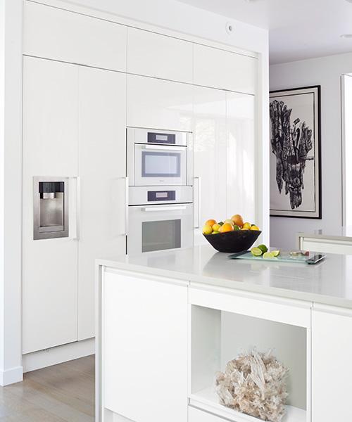 Luxury modern kitchen design in all white by William Ohs in Denver