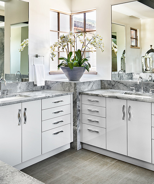 High-end bathroom remodel with white and grey accents designed by William Ohs in Denver