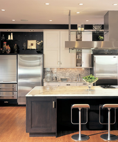 Luxury kitchen remodel with dark wood and white custom cabinetry by William Ohs in Denver