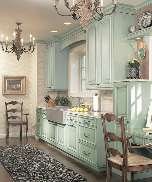 Light green custom cabinetry in kitchen by William Ohs in Denver
