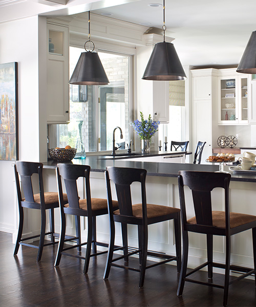 Matte black and white luxury kitchen remodel by William Ohs in Denver