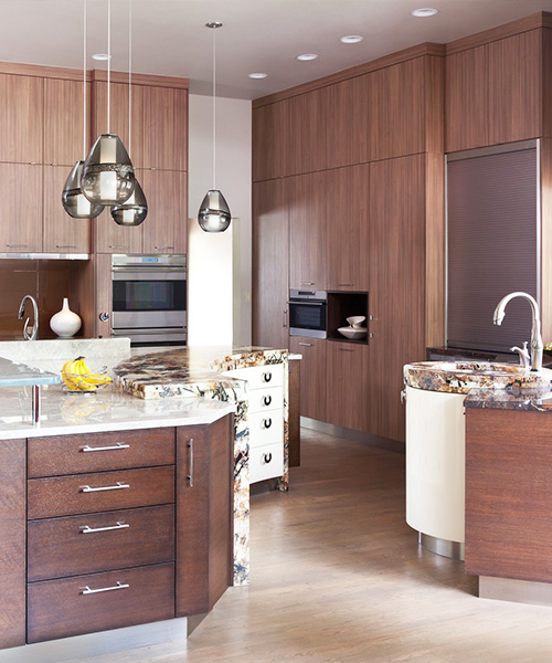 Medium-colored wood custom built cabinets in kitchen by William Ohs in Denver