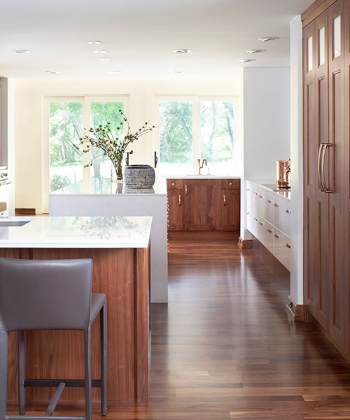 Light wood high-end kitchen cabinets custom built by William Ohs in Denver