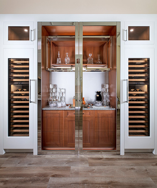 Custom built cabinets for wine cellar and wet bar by William Ohs in Denver