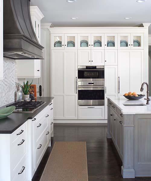 white kitchen with black countertops